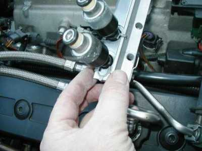 Plastic nipple from fuel injector stuck in motor    HELP